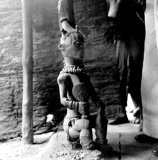 Figure in an ancestral shrine