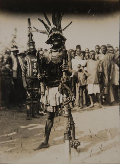 Igbo dibia at a masquerade dance, Nri-Awka Igbo